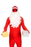 Santa in latex clothing holding gifts Stock Images