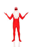 Santa in latex clothing showing copyspace Royalty Free Stock Image