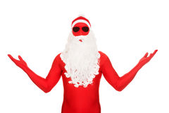Santa in latex clothing showing copyspace Royalty Free Stock Images