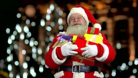 Santa laughing and holding presents. stock footage