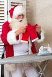 Santa with a laundry problem Stock Photos