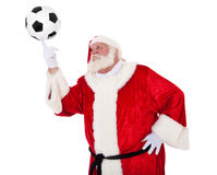Santa laus having fun with soccer ball Stock Photos