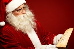 Santa with letter Stock Images