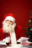 Santa with letters Stock Images