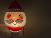 Festive Christmas Santa light in outlet. A santa night light at Christmas Royalty Free Stock Photography