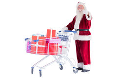 Santa likes to push a shopping cart with presents Stock Photography