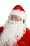 Santa Listens To Headphones Royalty Free Stock Photos