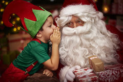 Santa with little boy Stock Images