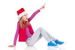 Santa Little Girl Pointing de sourire Images stock