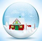 Santa logent (la sphère en verre) Photographie stock
