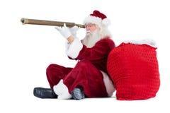 Santa is looking through his telescope Stock Photos