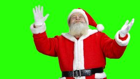 Santa is looking up and doing magic. stock video