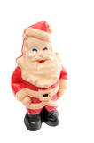 Santa looking up and smiling. Miniature santa wax candle figure looking up at the camera smiling isolated on white background Stock Photo