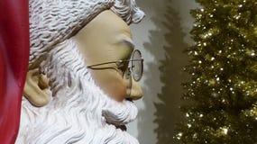 Santa Looks at a Christmas Tree Royalty Free Stock Photography