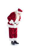 Santa looks down to personal scales Royalty Free Stock Photo