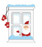 Santa looks from frozen window with mittens Stock Image