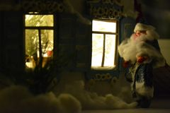 Santa looks in the New Year window. Retro New Year postcard with Father Frost wich is looking in the window in the night Stock Photography