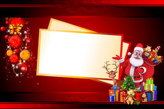 Santa with lots of gifts and big christmas cards Royalty Free Stock Photo