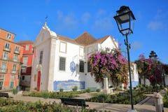 Santa Luzia viewpoint miradouro with Santa Luzia Church and colorful facades, Lisbon, Portugal Stock Photos