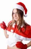 Santa młoda dziewczyna w Bożenarodzeniowym kapeluszu daje samochodu kluczowi obraz royalty free