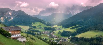 Santa Maddalena village, Val di Funes valley, Italy. Santa Maddalena village and church with Dolomites mountains on background, Val di Funes valley, Italy royalty free stock photo