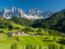 Santa Maddalena village in front of the Geisler or Odle Dolomites Group , Val di Funes, Italy, Europe. September, 2017 stock image