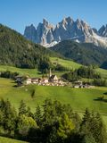Santa Maddalena village in front of the Geisler or Odle Dolomites Group , Val di Funes, Italy, Europe. September, 2017. Green grass, blue sky and high Stock Images