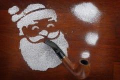 Santa made of snow spray smoking pipe Royalty Free Stock Photography