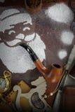 Santa made of snow spray smoking pipe Royalty Free Stock Image