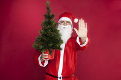 Santa makes a stop sign with his hand Stock Image