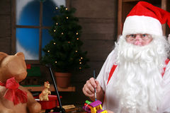 Santa makes toys in his workshop Royalty Free Stock Image
