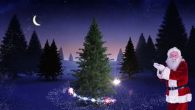 Santa making a magical christmas tree appear stock footage