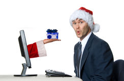 Santa man. Businessman in blue suit with a santa hat surprised stock photography