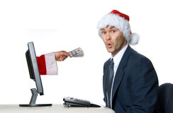 Santa man. Businessman in blue suit with a santa hat surprised royalty free stock photo