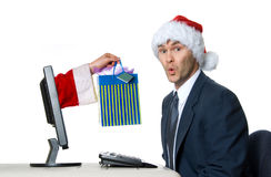 Santa man. Businessman in blue suit with a santa hat surprised royalty free stock photos