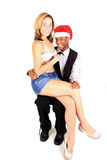 Santa Man. Man with santa cap with woman on his lap Royalty Free Stock Image