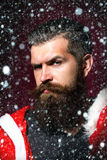 Santa man bends brows Royalty Free Stock Images