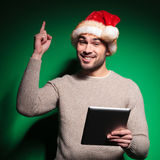 Santa man  having an  idea while reading on tablet Stock Photography