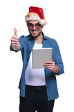 Santa man making the ok  sign while reading on tablet Stock Photos