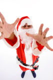Santa man with open palms. Against white background Royalty Free Stock Image
