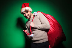 Santa man is playing with the bag Royalty Free Stock Image