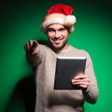Santa man is pointing finger while reading on tablet Stock Images