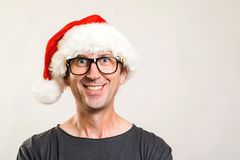 Santa man portrait. Christmas concept. Funny man wearing glasses and christmas hat. Happy New Year. Copy space. Santa man portrait. Christmas concept. Funny man royalty free stock photography