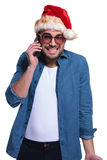 Santa man is receiving bad news on his phone Royalty Free Stock Images