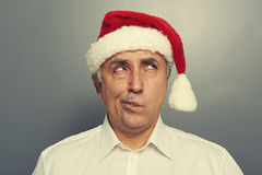 Santa man thinking and looking up Stock Images