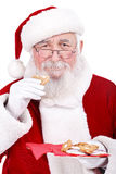 Santa mangeant le biscuit Photographie stock