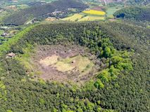 The Santa Margarida Volcano is an extinct volcano in the comarca of Garrotxa, Catalonia, Spain. The volcano has a perimeter of 2 km and a height of 682 meters royalty free stock photo