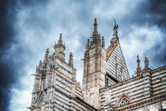 Santa Maria Assunta cathedral in Siena under a dramatic sky Royalty Free Stock Image