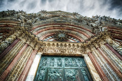 Santa Maria Assunta cathedral in Siena under a dramatic sky Royalty Free Stock Photography