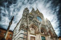 Santa Maria Assunta cathedral in Siena under a dramatic sky Stock Photos